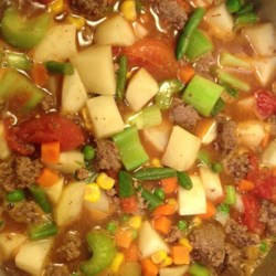 Cowgirl Stew Recipe - This is a pretty simple stew recipe using ground beef, potatoes, corn, and ranch-style beans simmering in a tomato-based sauce.