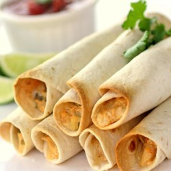 Great Chicken Taquitos Recipe - Homemade chicken taquitos filled with green onions, tomatoes, and plenty of seasoning are a great Mexican-inspired appetizer.