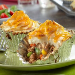 Mini Shepherd's Pies Recipe - Here's a new way to enjoy a classic comfort food! Your favorite shepherd's pie ingredients are combined, spooned into muffin-pan cups and baked to delicious perfection. Each mini pie is full of flavor and sure to become a weeknight family favorite.