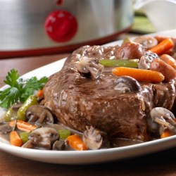 Ultimate Slow-Cooked Pot Roast Recipe - Pot roast goes upscale in this fantastic recipe featuring seasoned beef chuck roast that is slow cooked in an exquisite combination of fresh vegetables, fresh herbs, red wine, garlic, cream of mushroom soup and dry onion soup mix. The result is a mouthwatering meal that's guaranteed to impress!