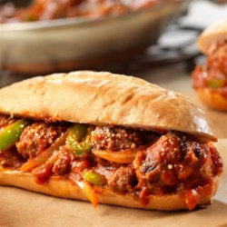 Spicy Sausage and Peppers Sandwiches Recipe - These easy-to-make sandwiches feature sautéed Italian sausage, onion and green pepper in a spicy jarred Italian sauce. So tasty, and on the table in just 35 minutes!