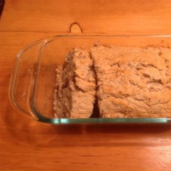 Sugar Free Banana Bread Recipe - A tasty sugar-free and dairy-free version of banana bread is easy to prepare when using unsweetened almond milk and stevia powder. Fold pine nuts and flax seeds into the batter for extra protein and crunch!