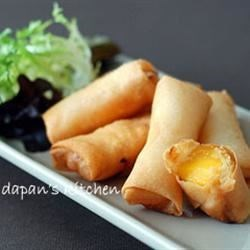 Mango Spring Roll Recipe - This refreshing appetizer will provide an unusually sweet note to the beginning of your meal. It can also be served as a fun dessert!