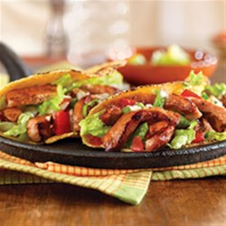 Honey and Spice Sautéed Pork Hand Tacos Recipe - Zesty pork tacos let you have more fun with flavor. Made with tender pork chops, honey and chipotle peppers, they're so delicious and so easy to prepare.