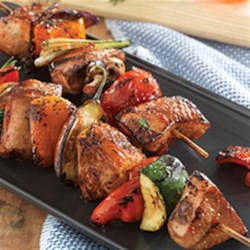 Make-It-Mine Pork Kabobs Recipe - Entertaining just got more delicious. These grilled pork kabobs are tender, juicy and so easy to customize with your favorite combination of herbs and vegetables.