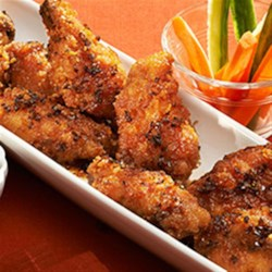 RITZ Spicy Asian Chicken Wings Recipe - RITZ spicy Asian chicken wings are delicious bites of sweet and spicy crowd-pleasing chicken, perfect for your Game Day party. The RITZ cracker breading adds a tasty crispy coating of buttery rich flavor that pairs splendidly with the Asian inspired sauce. Everyone wins when you serve these yummy chicken wings!
