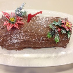Chocolate Decadence Yule Log Recipe - This rich chocolate cake, flavored with coffee liqueur and rolled up around a cream cheese filling, is a classic Christmas dessert.