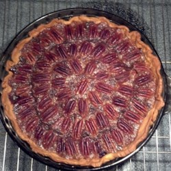 "Chocolate Pecan Pie I Recipe - ""This is my own invention--combining chocolate with a pecan pie seemed like such a good idea. I decided to try it, and the result was delicious. In place of instant coffee, try using espresso."""