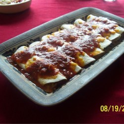 Red Enchilada Sauce Recipe - Tomato sauce is simmered with sauteed onion, salsa, and herbs, including cumin and oregano in this enchiladas recipe.
