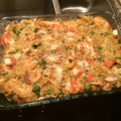 Savannah Seafood Stuffing Recipe - This is a seafood stuffing that has been in my family for a while. We have never actually stuffed the bird with this to avoid the turkey having a 'fishy' taste. We tend to like our dressing very moist, but if you prefer a drier stuffing, only use half of the broth.