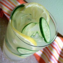 Cucumber Punch Recipe - This cool, refreshing punch is made with white grape juice, lemonade mix, and cucumbers. Garnish with thin-sliced lemons and cucumbers.