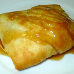 Banana Caramel Fluff Recipe - Refrigerated crescent roll dough is stuffed with a sweet mixture of mashed banana, vanilla and melted butter, and then it's baked until golden and topped with a luscious caramel topping.