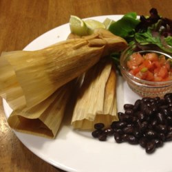 Leftover Turkey Tamales Recipe - Leftover holiday turkey can be transformed into turkey tamales made with corn oil instead of lard. Serve with lime wedges.
