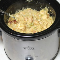 Slow Cooker Chicken and Dressing Recipe - Delicious, moist cornbread dressing and cooked chicken simmer for hours in a slow cooker for a great meal that frees up both you and your oven during a busy day.
