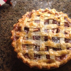 Cranberry Apple Pie II Recipe - Whole cranberry sauce and brown sugar, combined with nutmeg and cinnamon, go into this great holiday apple pie.