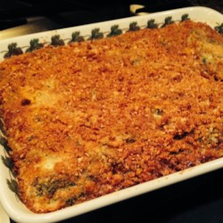 Baked Spinach Recipe - Copped spinach leaves are layered with flour and beaten eggs. Cheese and breadcrumbs go on next, and then milk and melted butter are poured over everything. An hour later, it's done. It's great for dinner parties and family meals.