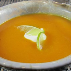 Curried Butternut Squash Soup with Lime Cream Recipe - Curried butternut squash with a dollop of lime cream is a nice way to keep warm on those cold autumn nights.
