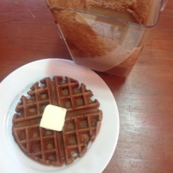 Carlie's Chocolate Oatmeal Waffles Recipe - Cocoa powder gives these hearty, not-too-sweet oatmeal waffles a delicious chocolate flavor.