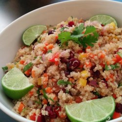 Cranberry and Cilantro Quinoa Salad Recipe - Quinoa is tossed with toasted almonds, dried cranberries, bell peppers, curry powder, and fresh cilantro in this tasty salad.