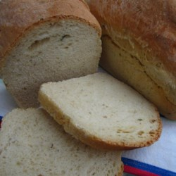 Habanero, Rosemary, and Cheddar Bread Recipe - Two kinds of yeast plus baking powder give lift to a savory bread flavored with fruity, hot habanero pepper, rosemary, and Cheddar cheese. The recipe makes 2 loaves that are perfect for your Mexican-themed dinner or just to slice and serve with a bowl of chili.