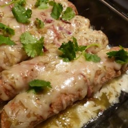 Easy Green Chile Chicken Enchiladas Recipe - These fresh tasting chicken enchiladas are bathed in lots of zippy green enchilada sauce and tamed with just a bit of shredded 2% cheese.