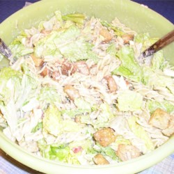 Macaroni Caesar Salad Recipe - This salad takes everything from a Caesar salad.. but take away some of the lettuce and add macaroni, and you have a whole new dish! You can add any noodle you desire! It is very delicious and easy to make.