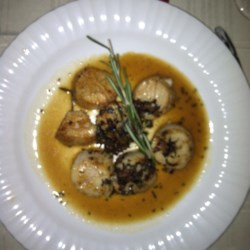 Sauteed Scallops Recipe - A very simple recipe for how delicious it is!  Just crush the garlic with the side of a chef's knife blade instead of chopping it, and using whole sprigs of rosemary allows them to be easily removed before serving.