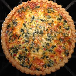 Transformed Spinach Mushroom Quiche Recipe - Spinach, mushrooms, feta, and Swiss cheeses fill this moist veggie quiche with flavor. Add sausage if you like. The recipe is easily doubled.