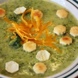 Cream of Broccoli Soup I Recipe - Half of the blanched broccoli in this recipe is pureed and added to a creamy broth, while the other half is roughly chopped and folded into the soup base with a dash of nutmeg.  Serve garnished with grated cheddar cheese.