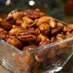 Sweet, Salty, Spicy Party Nuts Recipe - Mix walnuts, pecans, almonds, and cashews with a sweet and salty spice mixture before roasting them to crunchy perfection.