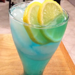 Electric Lemonade Recipe - Citron vodka, blue curacao and sour mix filled out with citrus soda and garnished with a lemon wedge. It's electrifyin'!