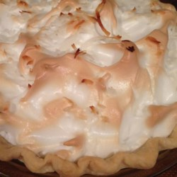 Mom's Chocolate Meringue Pie Recipe - Rich, creamy and very chocolaty, this pie 's ingredients are simmered slowly on the stove until they perfectly blend and the filling is thick and ready to pour into a pie shell. The chocolate custard pie is topped with a glossy meringue and slipped into the oven.