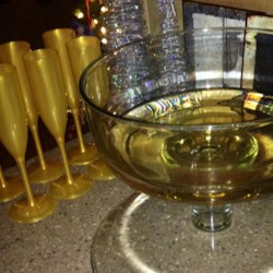 Mock Champagne Recipe - You'll want to serve this golden 'mocktail' in a real champagne glass: The ginger ale and white grape juice base looks like the real McCoy.