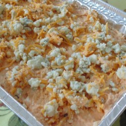 Easy Buffalo Chicken Dip Recipe - Converting the idea of Buffalo-style chicken wings to a dip that can be served with chips, crackers, or vegetables is the genesis of this recipe perfectly tailored to your next football-watching party or even for Oscars night!