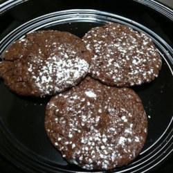 Chocolate Crisps Recipe - This recipe makes thin, dark chocolate cookies flecked with more chocolate.