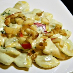 Gorgonzola Cream Sauce Recipe - Tiny stuffed ravioli are served in a sauce made of thickened cream flavored with tangy Gorgonzola cheese and Parmesan for a quick gourmet dish.
