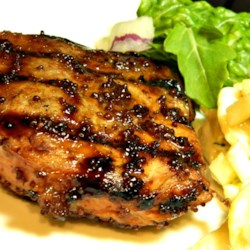 Dijon Grilled Pork Chops Recipe - Pork chops are marinated in a Dijon mustard sauce and grilled to create a tangy and sweet main dish. Serve with applesauce and mashed potatoes.