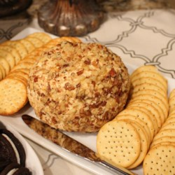 Herman Reunion Cheese Ball Recipe - The requests for this family recipe never stop, so here it is for everybody to enjoy. These cheese balls freeze well for months and make wonderful holiday gifts. To give the balls as gifts: wrap each ball or log  individually in festive holiday plastic wrap.