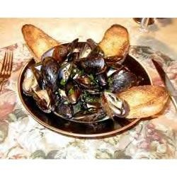 Million Dollar Mussels Recipe - These mussels I originally had in Cape Cod Massachusetts about 20 years ago. This is my version of them, and it is even better than the original. Pair with a large loaf of crusty bread to soak up the generous sauce.