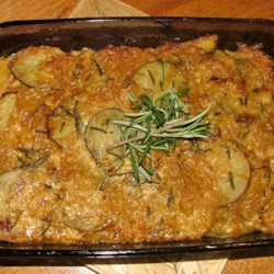 Amanda's Potatoes Recipe - A gourmet twist on Potatoes Au Gratin with caramelized onions and fresh herbs. Great for brunches and potlucks.