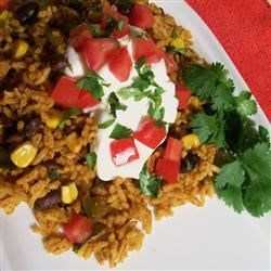 Dee's Mexican Rice Recipe - Easy, spicy rice. Serve with a dollop of sour cream.   To make this a main dish: add 1/2 can black or kidney beans when you add the rice.