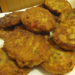 Fried Black-Eye Peas Recipe - Black-eyed peas are mashed with crumbled bacon and roasted red pepper, then formed into patties, and fried until golden, crispy, and delicious.
