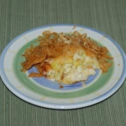 Squash Casserole II Recipe - Squash mashed with butter, mayonnaise, eggs and sugar is baked with a crunchy bread crumb, cheese and French fried onion ring topping in this casserole to serve with turkey or ham.