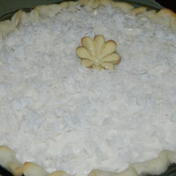 White Christmas Pie Recipe - This creamy coconut chiffon pie is topped with a layer of flaked coconut, to resemble a blanket of snow on Christmas morning.
