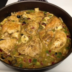 Citrus Chicken Recipe - Chicken breasts lightly seasoned and sauteed, then braised with orange juice and vegetable stock; with the delightful addition of herbs, onion, bell pepper and mushrooms this dish is a unique blend of flavors. The addition of black olives at the end is optional.