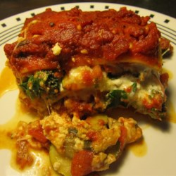 Easy Roasted Vegetable Lasagna Recipe - Zucchini, bell peppers, mushrooms, and onion are roasted in the oven before being layered between noodles, tomato sauce, and plenty of mozzarella and Parmesan cheese.