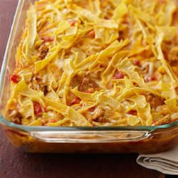 Chicken Tortilla Bake Recipe - Seasoned chicken breast strips layered with tortilla strips are baked in a creamy sauce with tomatoes and corn and topped with shredded Mexican cheese blend.