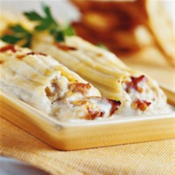 Creamy Chicken Manicotti Recipe - With prepared grilled chicken strips, classic chicken manicotti filled with Parmesan cheese, ricotta, chopped chicken and more are baked in a creamy sauce for an easy and impressive dinner.