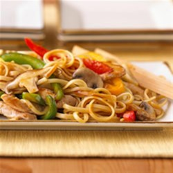 Stir-Fry Chicken Lo Mein Recipe - Stir-fried mushrooms and veggies are quickly simmered with cooked chicken breast strips and stir-fry sauce then served over hot cooked linguine.
