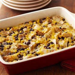 Chicken-Black Bean Casserole Recipe - Black beans, corn and green salsa with seasoned chicken strips are topped with shredded cheese and baked for a hearty and delicious one-dish meal.